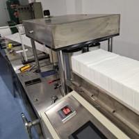 浙江湖州同辉生产点断式一次性床单折叠机,美容床单机。